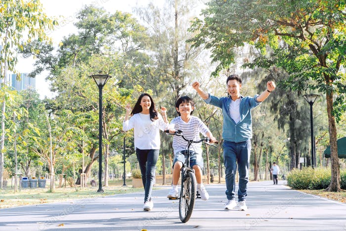 Asian parent support on riding bicycle