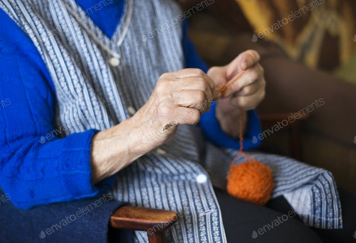 Senior woman knitting