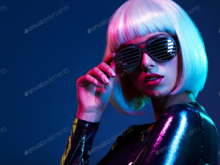 Stylish blonde in shiny dress and sunglasses with stresses.