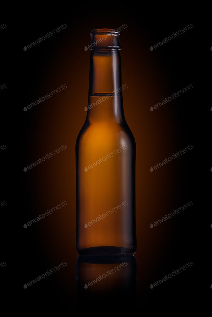 Brown small bottle full of liquid on a black background