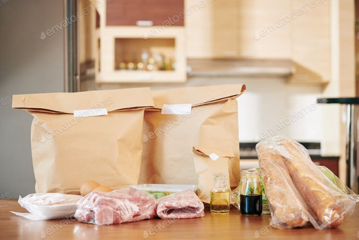 Packed groceries on kitchen table