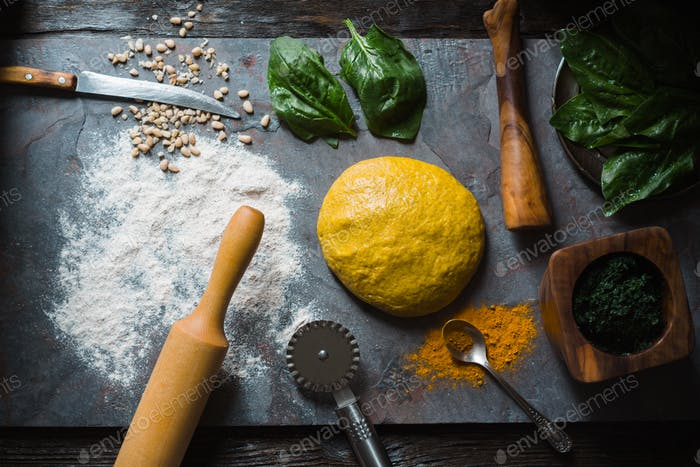 Ingredients for cooking ravioli dough with turmeric, spinach