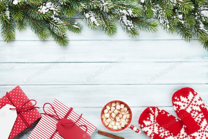 Christmas background with fir tree, gifts, hot chocolate