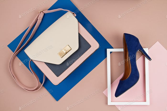Elegant woman accessories hand bag and high heel shoes