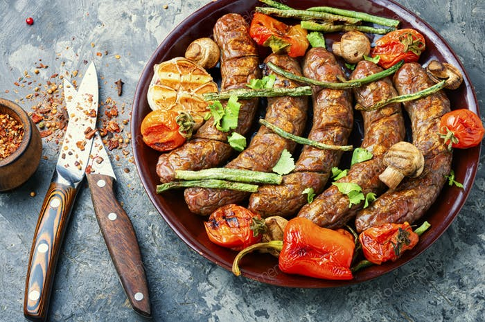 Sausages fried with vegetable