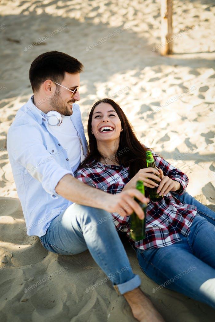 Lovers enjoying sunny day at the beach