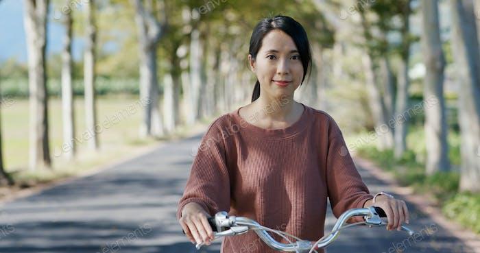 Woman ride a bike in countryside