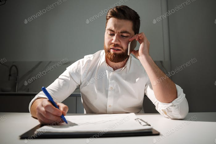 Portrait of a busy young businessman