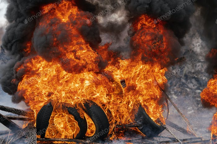 Thumbnail for Burning Automobile Tires, Strong Flame of Red Fire, Clouds of Black Smoke in Sky
