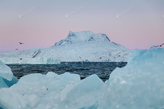 Snowcapped mountain against clear sky at sunset