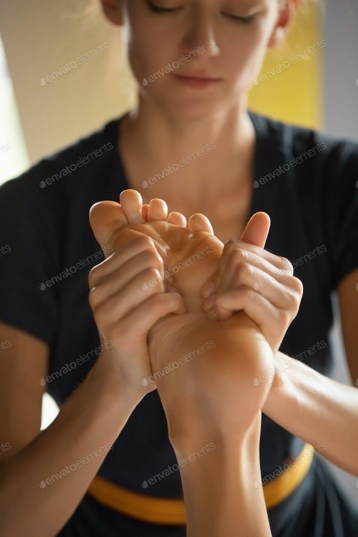 Foot massage in spa salon