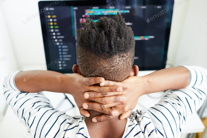 Busy software engineer checking code