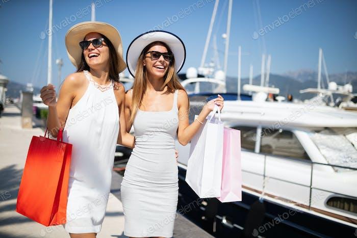 Happy tourist friends having fun on summer travel vacation