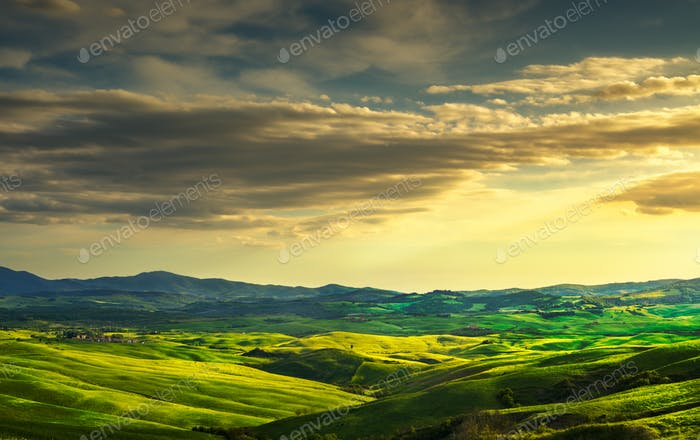 Volterra panorama, rolling hills and green fields on sunset. Rur