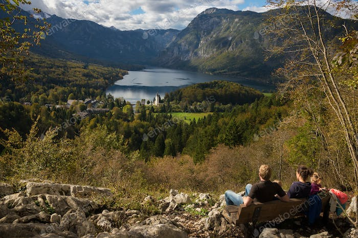 Family resting with a view over Lake Bohinj
