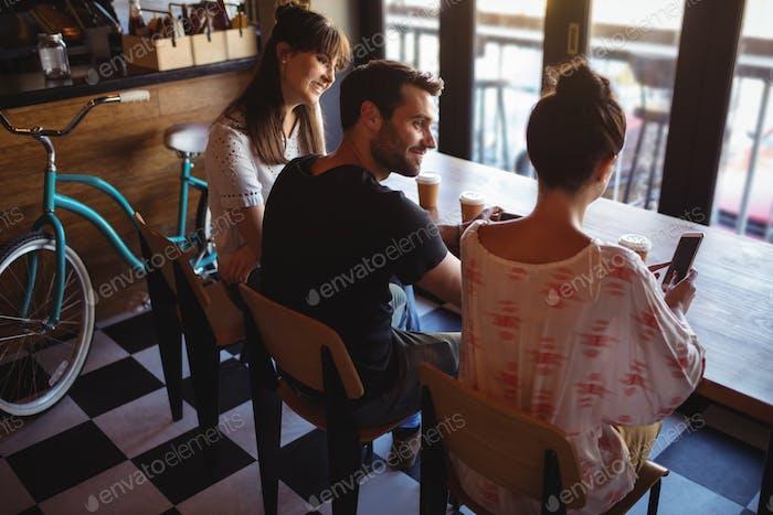 Friends having coffee at restaurant