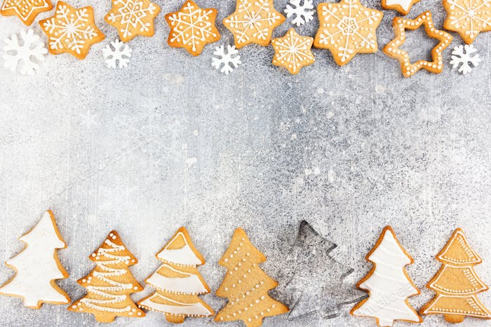 Christmas pattern of gingerbread cookies in the shape of Christmas tree and snowflakes
