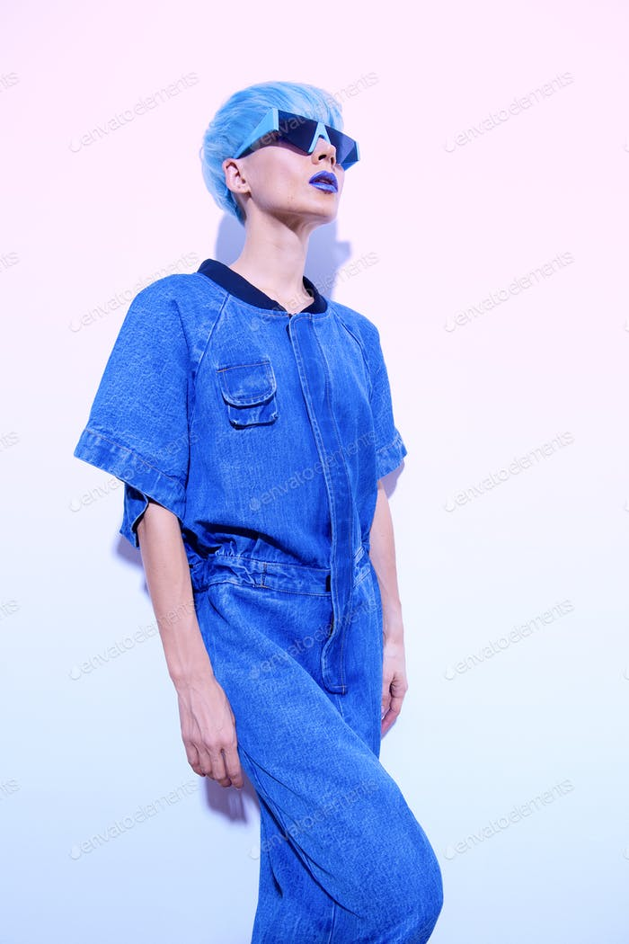 fashion Girll with short blue colored hair and stylish denim clothes. Trendy haircut concept