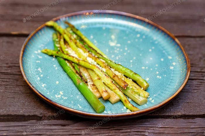 Close up delicious grilled asparagus on plate