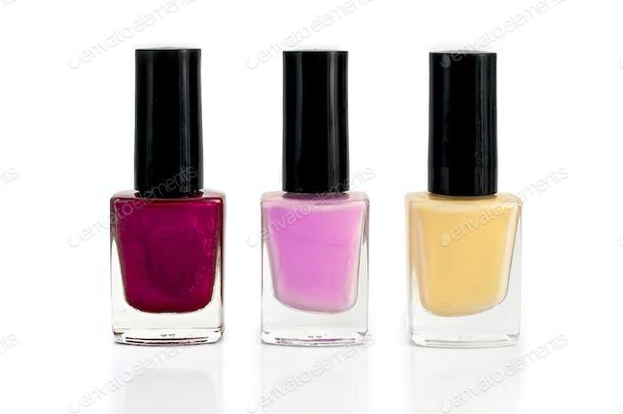 Nail polish bottles in three