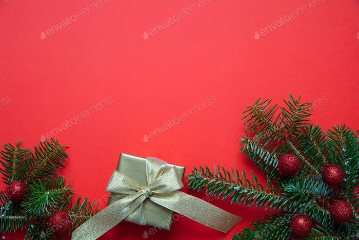 Christmas fir decoration against red color background