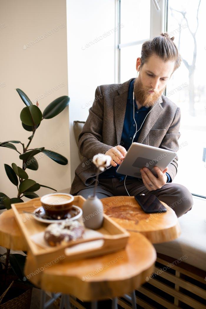 Busy freelancer working in cozy coffee shop
