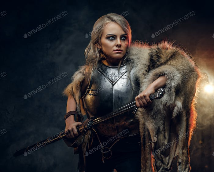 Fantasy woman knight wearing cuirass and fur, holding a sword scabbard ready for a battle