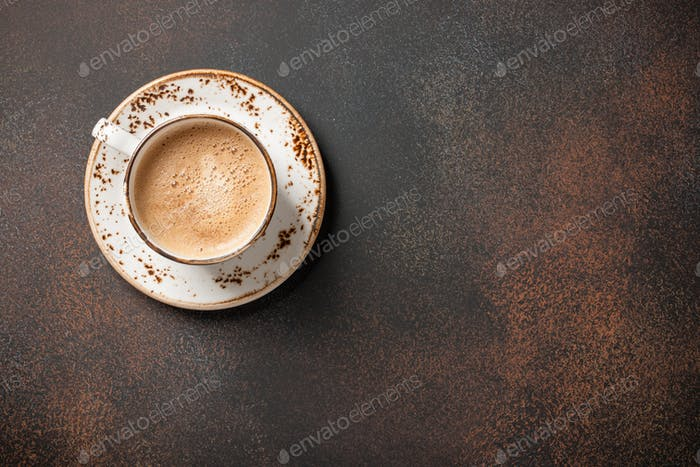 Cup of coffee on rusted surface