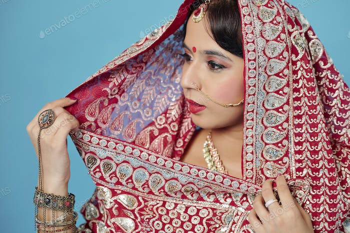 Pretty woman in wedding sari