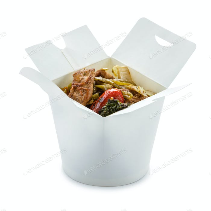Spinach noodles with chicken and vegetables in take-out box over