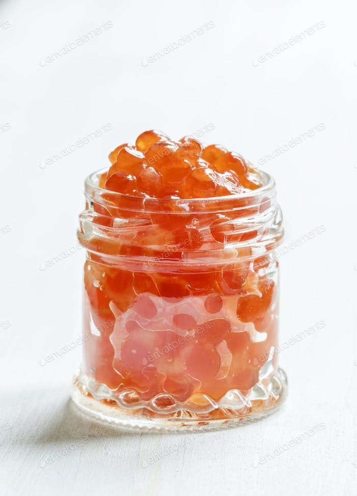 Red salmon caviar in a glass jar