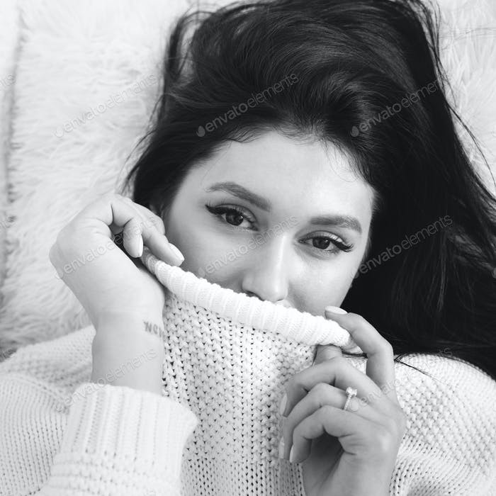 Beauty monochrome portrait of gorgeous brunnete wearing white knitted sweater