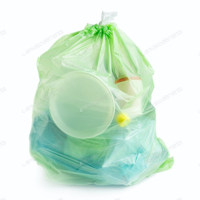 Plastic bag full of plastic trash on white