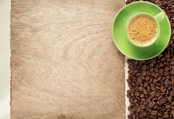 coffee beans and saucer on wooden background