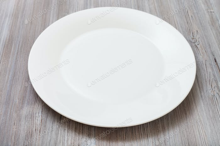 white plate on gray brown table