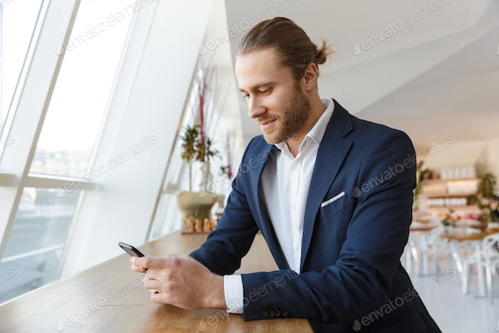 Pleased handsome young businessman