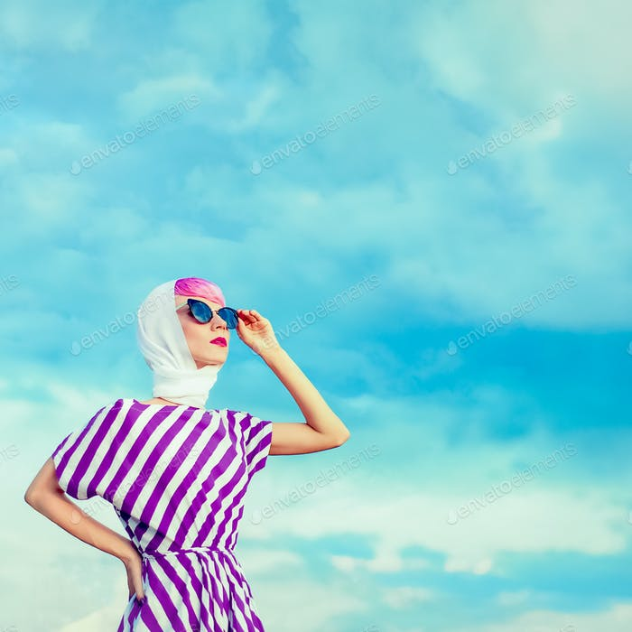 Portrait of retro girl on the blue sky