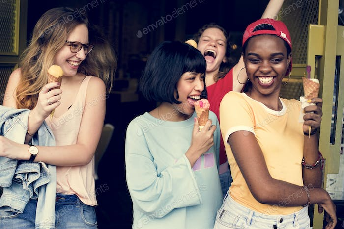 Group of diverse women eating ice cream together