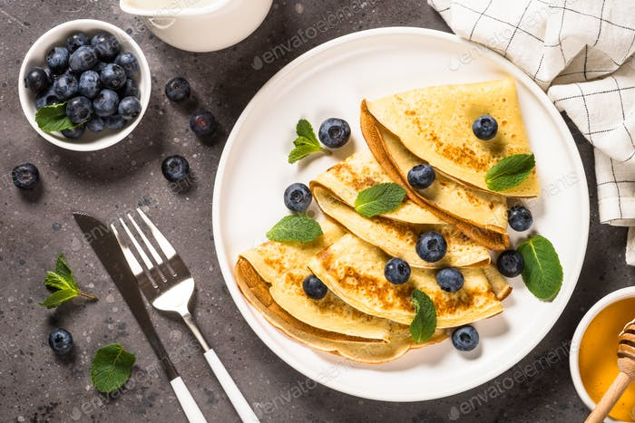 Crepes with blueberries and honey
