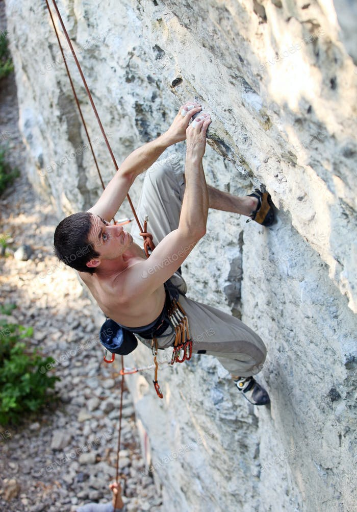 Rock climber focusing on the next movement