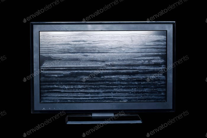 Old television on black background
