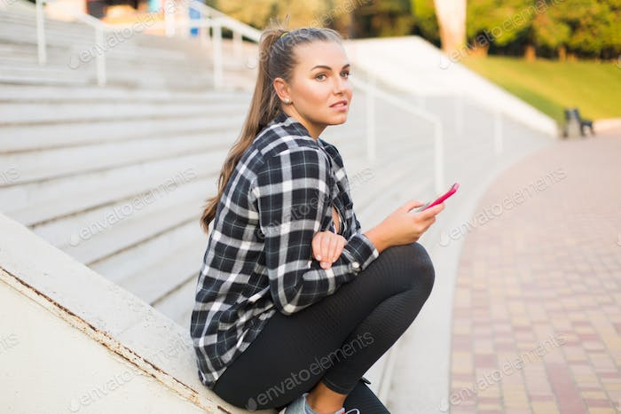 Young beautiful plus size woman in casual shirt and leggings lea