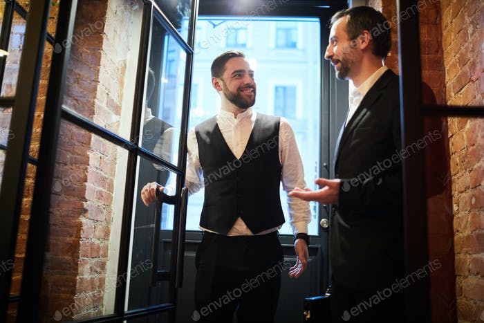 Two Business people Entering Restaurant