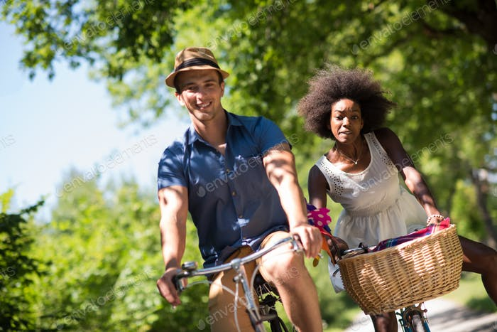 Young  couple having joyful bike ride in nature