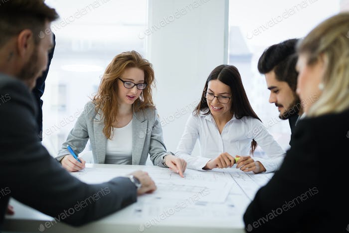 Young smart business people meeting in business office