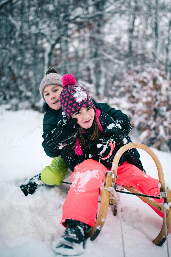 Two kids having fun on snow
