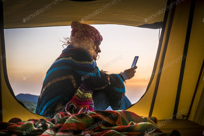 Freedom and adventure travel vacation alternative leisure activity lifestyle with woman in a tent