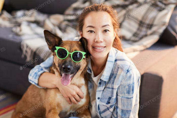 Asian Woman Posing with funny Dog