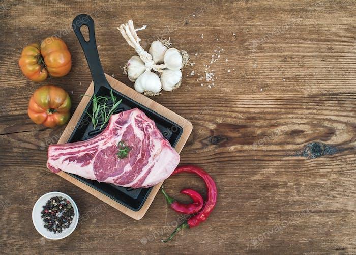 Raw fresh meat ribeye steak with pepper, salt, chili, garlic