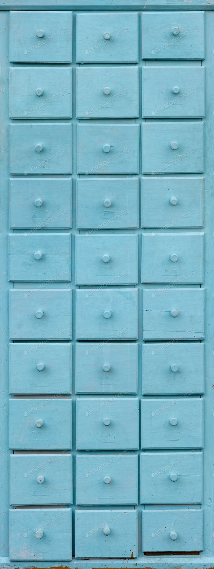 Blue wooden closet with drawers